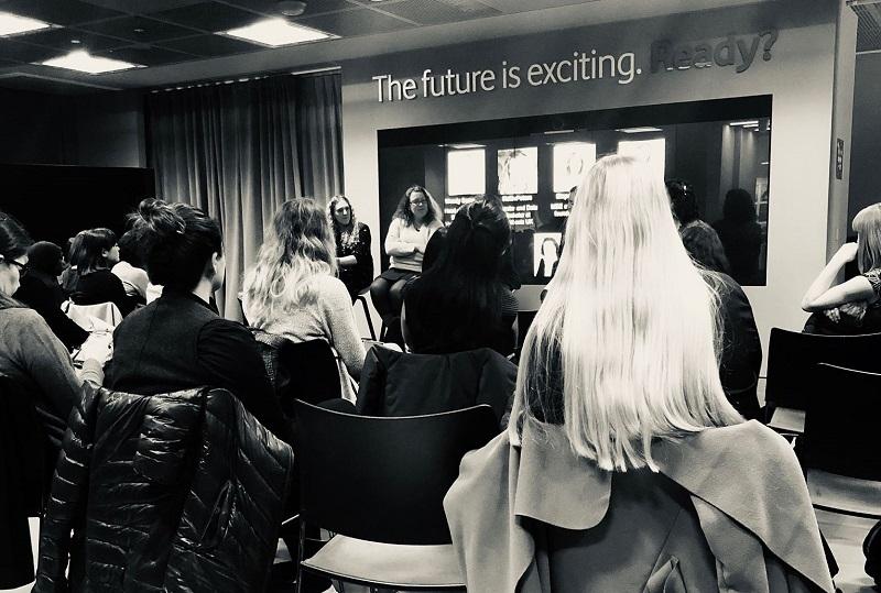 Women watching big data speakers